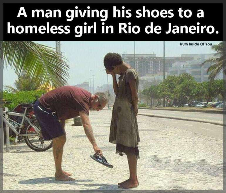 A man giving his shoes to a homeless girl in Rio de Janeirojpg