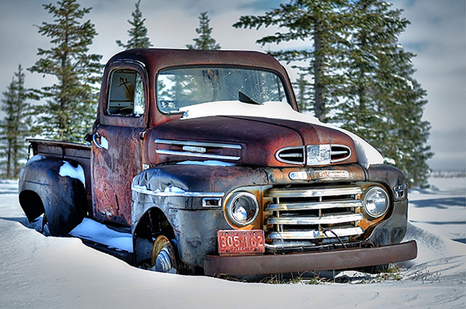 old work truck in snow